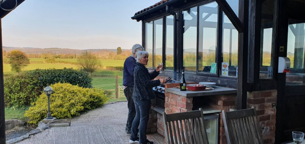 David Sue trying out the new BBQ with of course a glass of Prosecco 😊